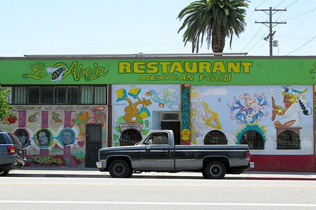 La Abeja restaurant green exterior with truck out front