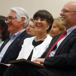 Tom Buchanan, University of Wyoming President, laughs with his wife Jacque before announcing his resignation during his State of the University speech on Thursday, Sept. 6, 2012 in the UW Student Union.