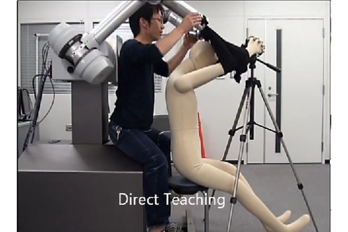 Robot learning puts shirt on