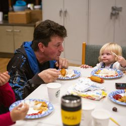 Matthew Branstetter eats with daughters Lucy, 6, and Julianna,1, at Lake Washington United Methodist Church in Kirkland, Wash., on Sunday, Oct. 13, 2019. The family has been using the Safe Parking program for the past several months, first becoming homeless in December 2018.The family is on a wait list for transitional housing and is hoping to hear back about an apartment soon.