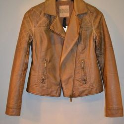 """""""This jacket is my adorable new best friend! Fully lined with quilting details, this faux leather jacket will go everywhere with you."""" BB Dakota faux leather motorcycle jacket, $112, at Muse Boutique in Oak Park (708.948.7052.)"""