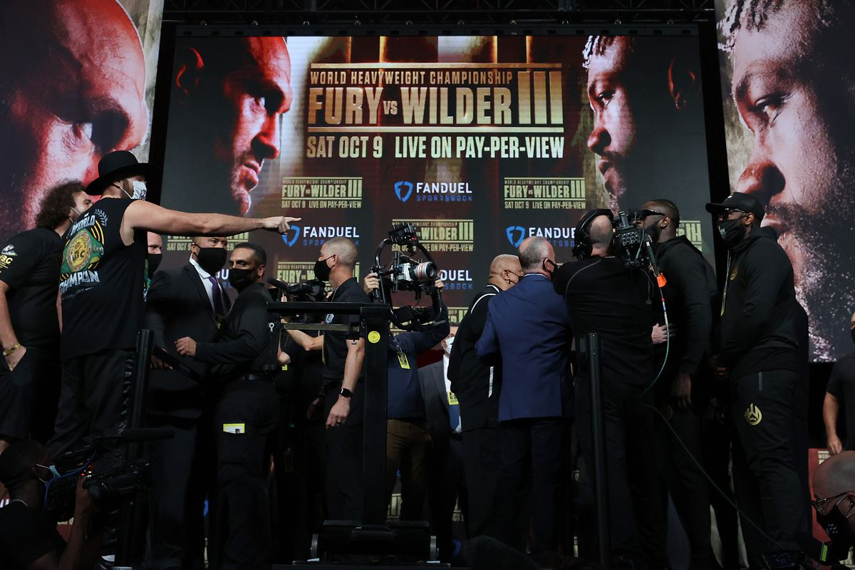WBC heavyweight champion Tyson Fury taunts Deontay Wilder during his official weigh-in at MGM Grand Garden Arena on October 8, 2021 in Las Vegas, Nevada.
