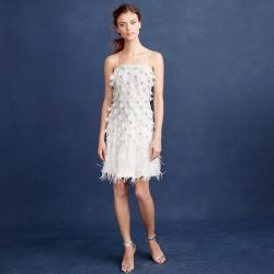If you're a dress girl through-and-through, but you want something a little different than your mother's vintage gown, go short. Find a bright white mini with feathers, rosettes, or some other detail that makes it extra special.