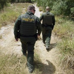 File - In this June 8, 2011, file photo, U.S. Customs and Border Patrol agents patrol along the Rio Grande near Penitas, Texas. An unprecedented surge of children caught trudging through South Texas scrublands or crossing at border ports of entry without their parents has sent government and nonprofit agencies that handle their shelter, legal representation and reunifications scrambling to expand their services.