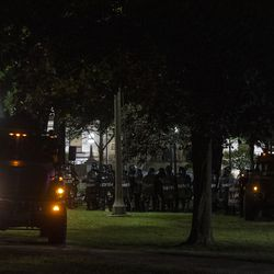 Police march behind bearcats after clearing out Civic Center Park during a protest over the shooting of Jacob Blake, Tuesday, Aug. 25, 2020, in Kenosha, Wis.