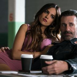"""Buddy (Jon Hamm) and Darling (Eiza Gonzalez) find out why Baby always listens to music in """"Baby Driver."""""""