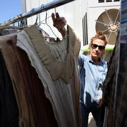 Rebecca Berry, seamstress, moves costumes on the set of the Book of Mormon Visual Library at LDS Motion Picture Studios South Campus near Goshen on Friday, July 7, 2017.