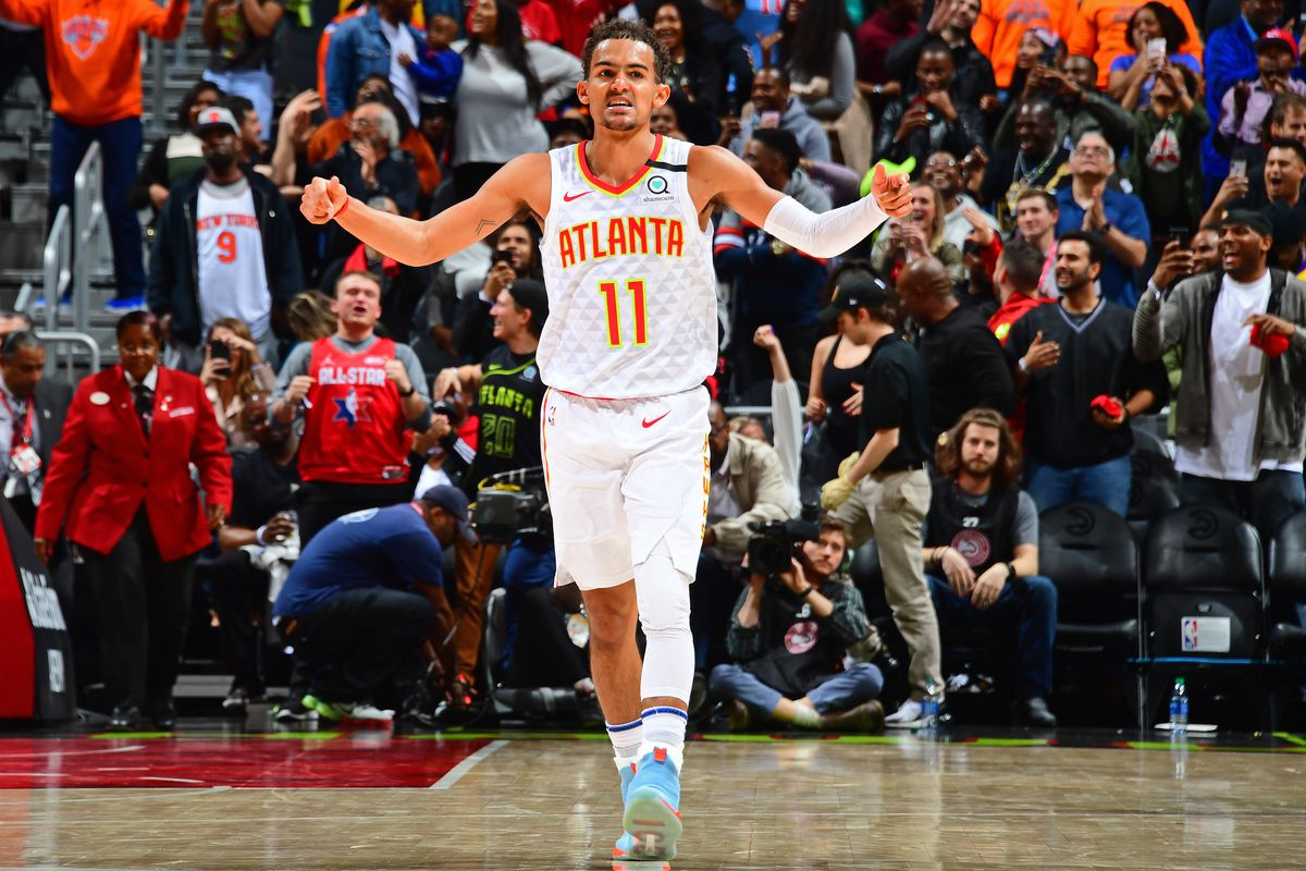 Trae Young of the Atlanta Hawks reacts to play on March 11, 2020 at State Farm Arena in Atlanta, Georgia.