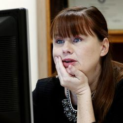 Patricia Abbott Lammi reads on her computer as she describes her work at the Utah Health Department on Tuesday, May 2, 2017. Patricia and her husband Phillip juggle their work schedules to make things work out with their two kids Luke and Juliet.