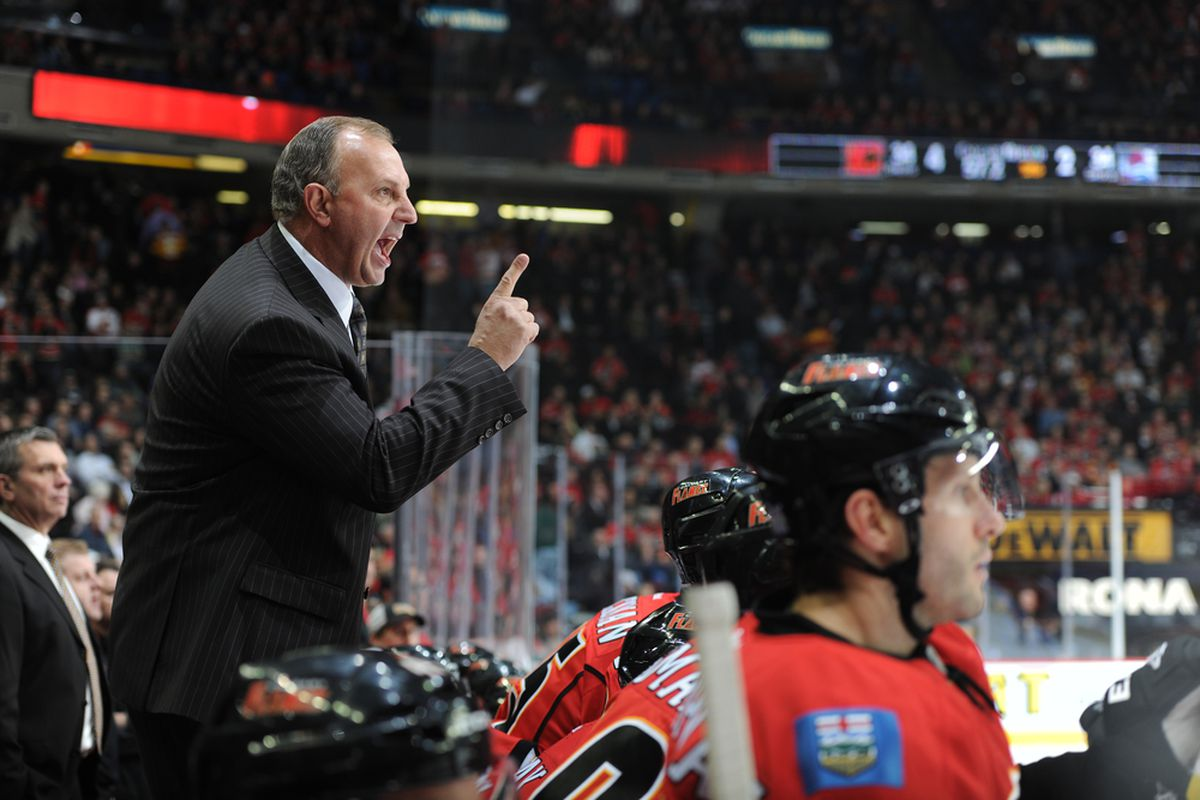 CALGARY, CANADA - OCTOBER 26: Head coach Brent Sutter is his usual self beaming love and joy into the universe as he says pull my finger to the ref. (Photo by Dale MacMillan/Getty Images)