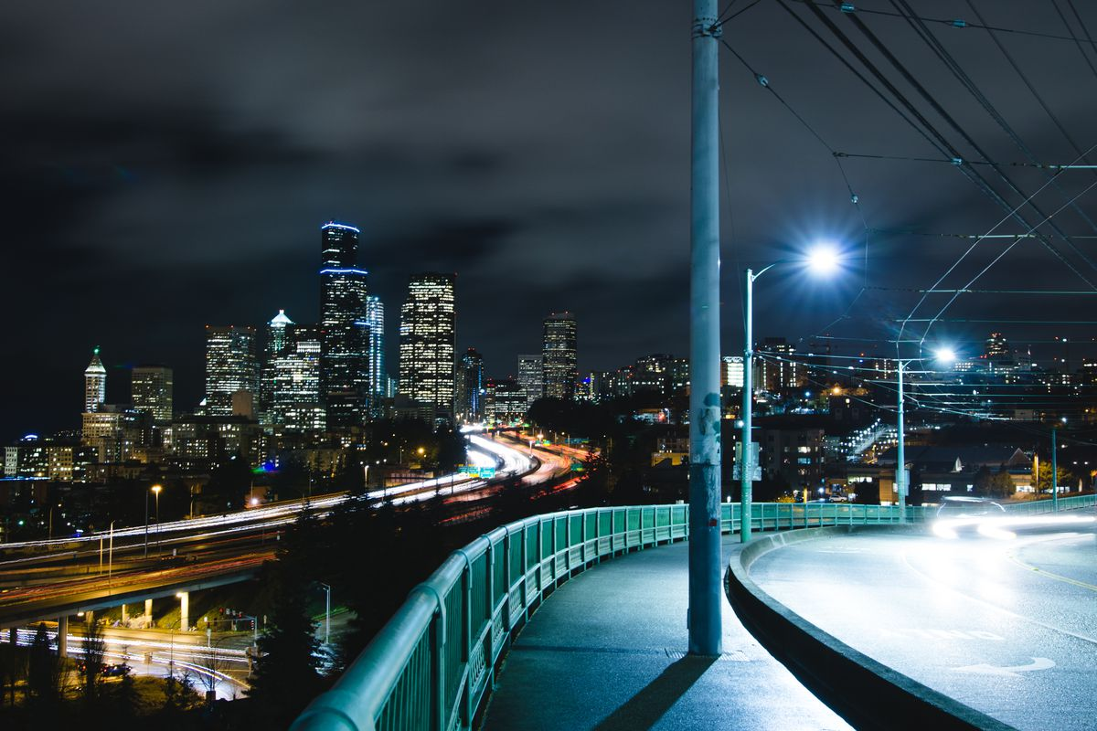An empty Seattle street at night with the skyline in the background
