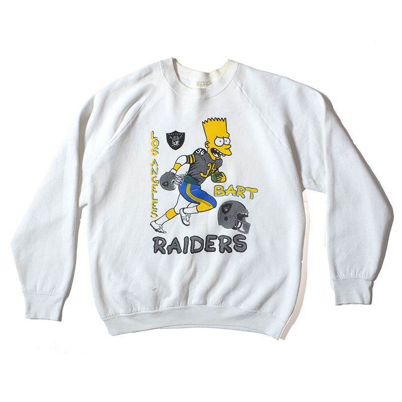 A white sweatshirt with a bootleg Bart Simpson playing football for the Raiders