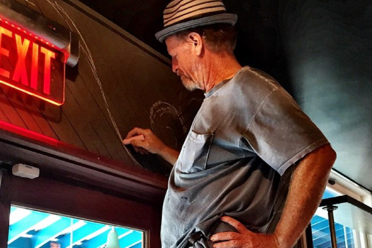 Artist David Boatwright Putting The Finishing Touches On Screen Door