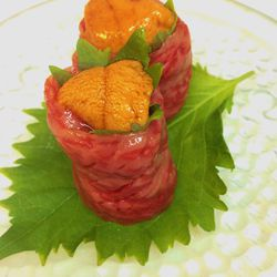 Imported Kuroge Wagyu sashimi with uni and ooba leaf.