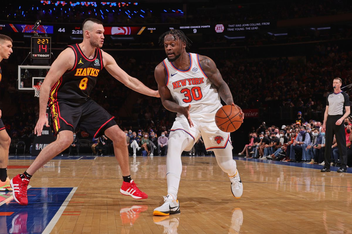 Danilo Gallinari #8 of the Atlanta Hawks plays defense on Julius Randle #30 of the New York Knicks during Round 1, Game 1 of the 2021 NBA Playoffs on May 23, 2021 at Madison Square Garden in New York City, New York.