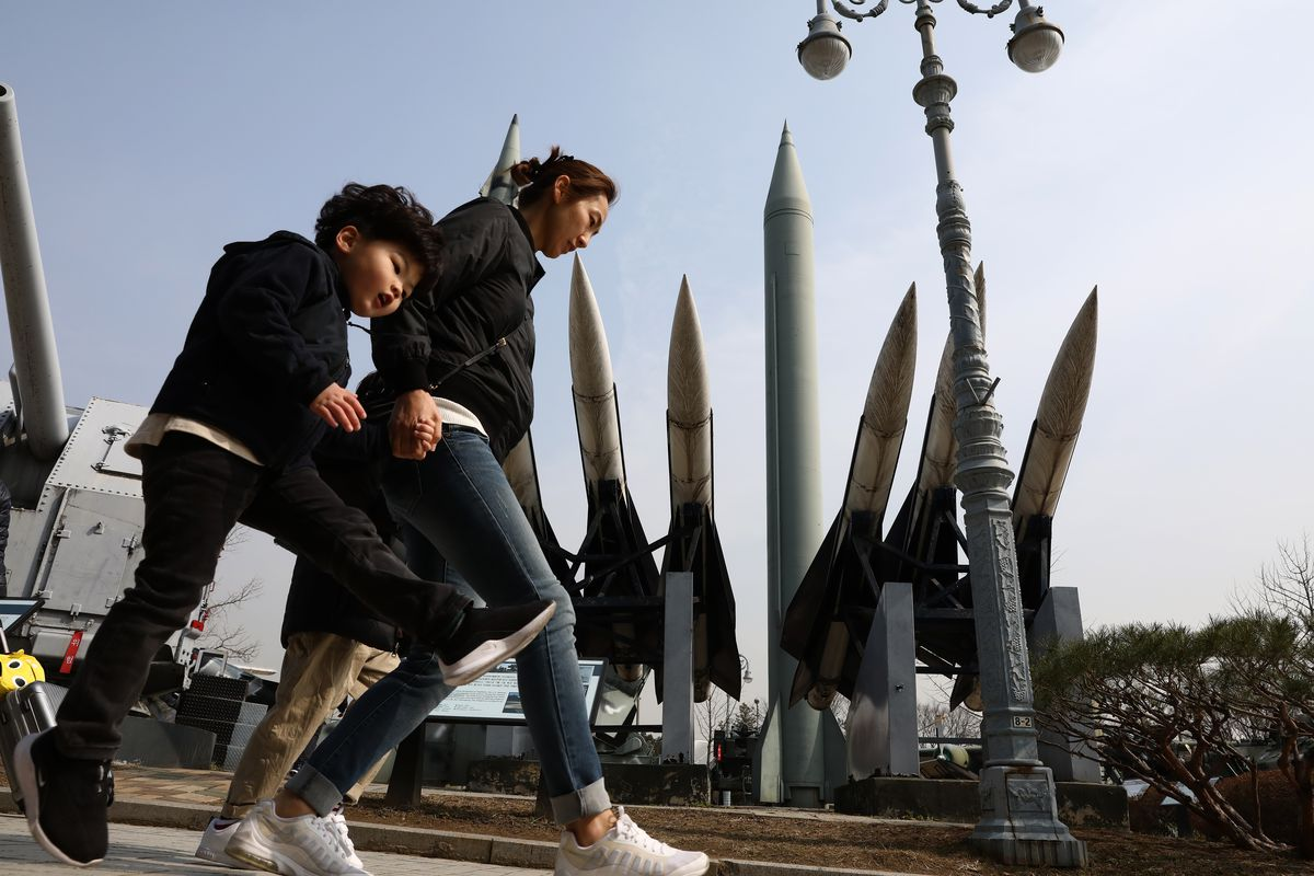 South Koreans walk past replicas of North Korean and South Korean missiles on February 28, 2019 in Seoul.North Korea tested a short-range missile on May 3, 2019.