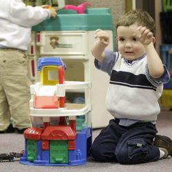 LDS nursery kids play with toys on Sunday, Jan. 31, 2010.