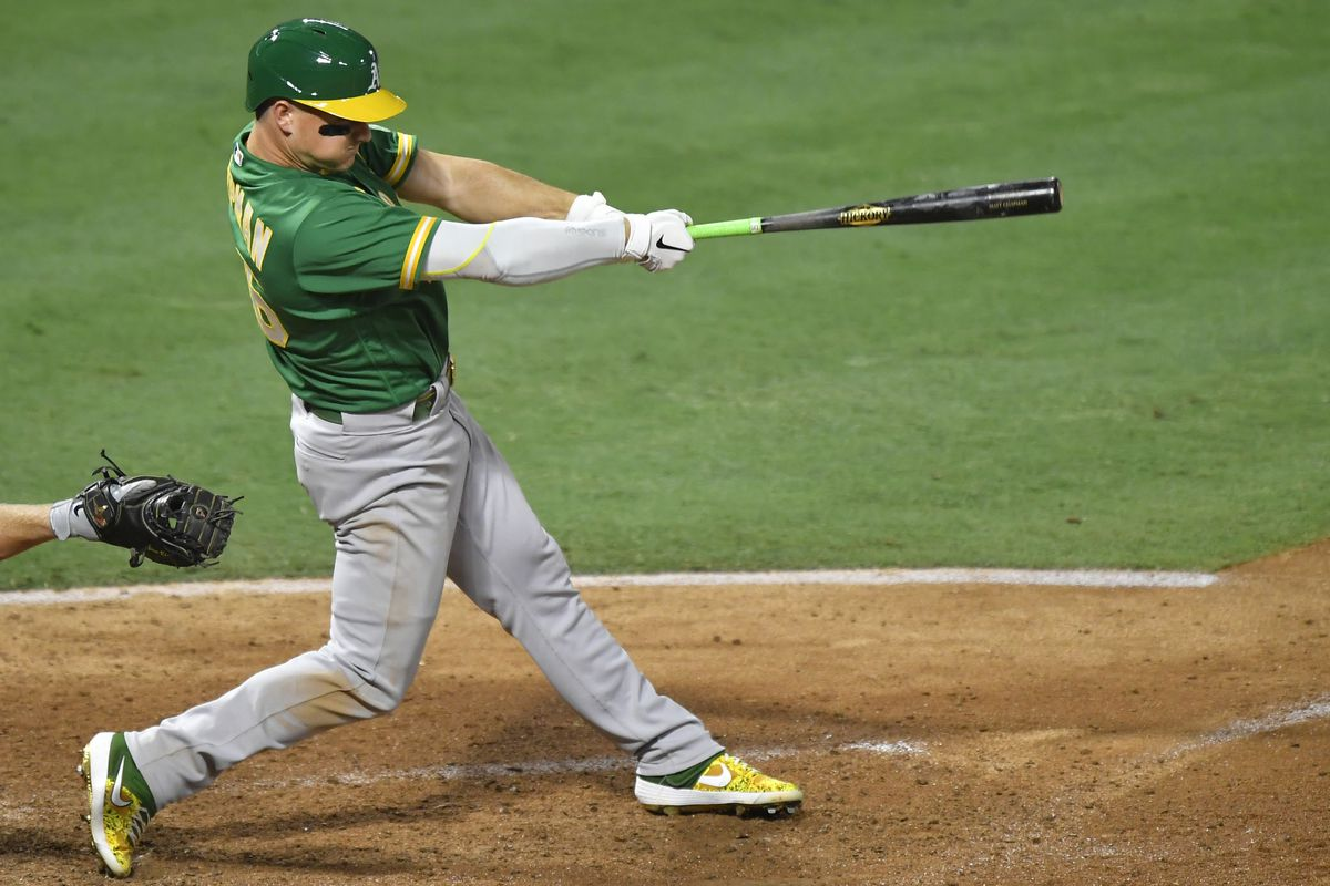 Matt Chapman #26 of the Oakland Athletics hits a three-run triple in the fourth inning against the Los Angeles Angels at Angel Stadium of Anaheim on August 10, 2020 in Anaheim, California.