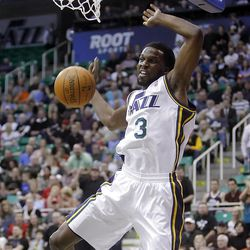 Utah Jazz DeMarre Carroll (3) completes a dunk as the Utah Jazz and the Denver Nuggets play Friday, March 23, 2012. Jazz win 121-102.