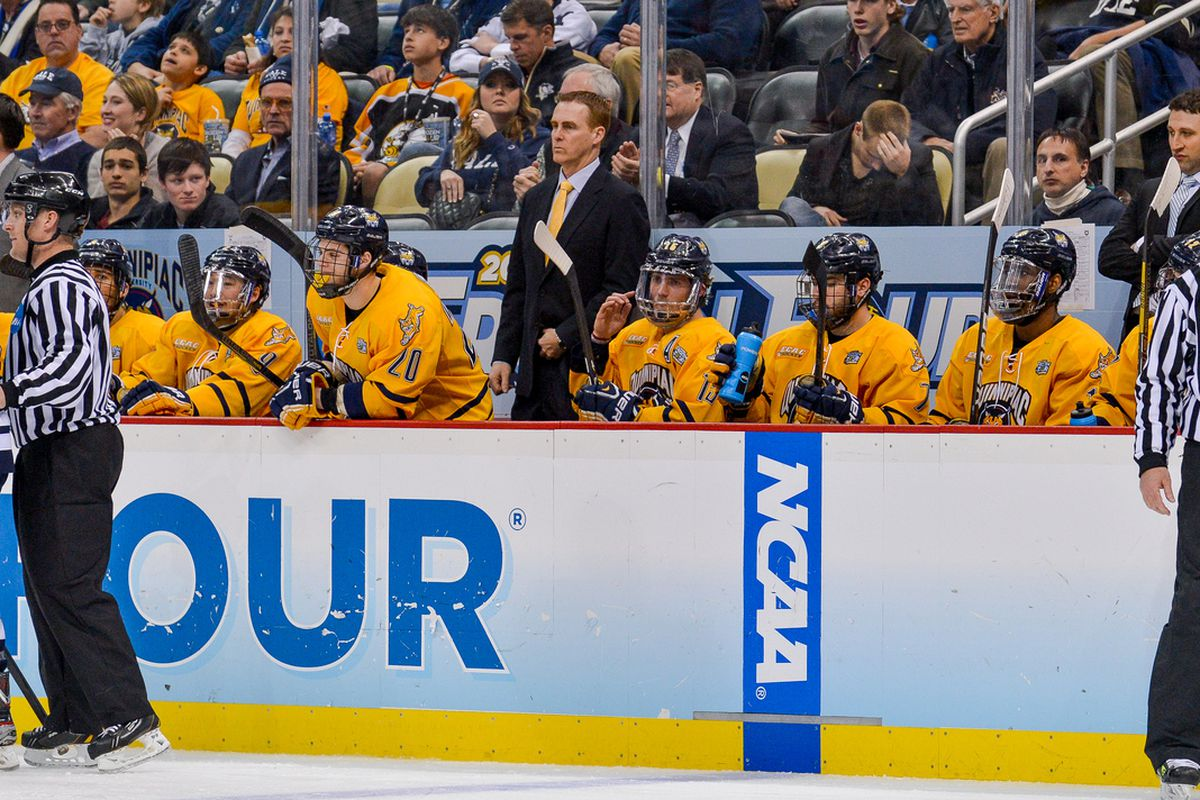 Quinnipiac head coach Rand Pecknold behind the bench for the Bobcats during the 2013 Frozen Four in Pittsburgh, Penn.