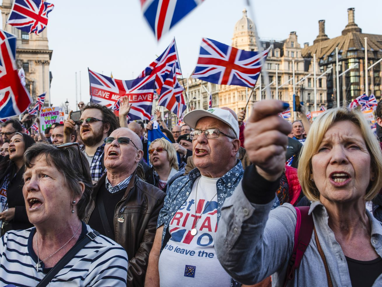 Pro-Brexit demonstrators gather in Parliament Square to listen to Nigel Farage speak in London on March 29, 2019.
