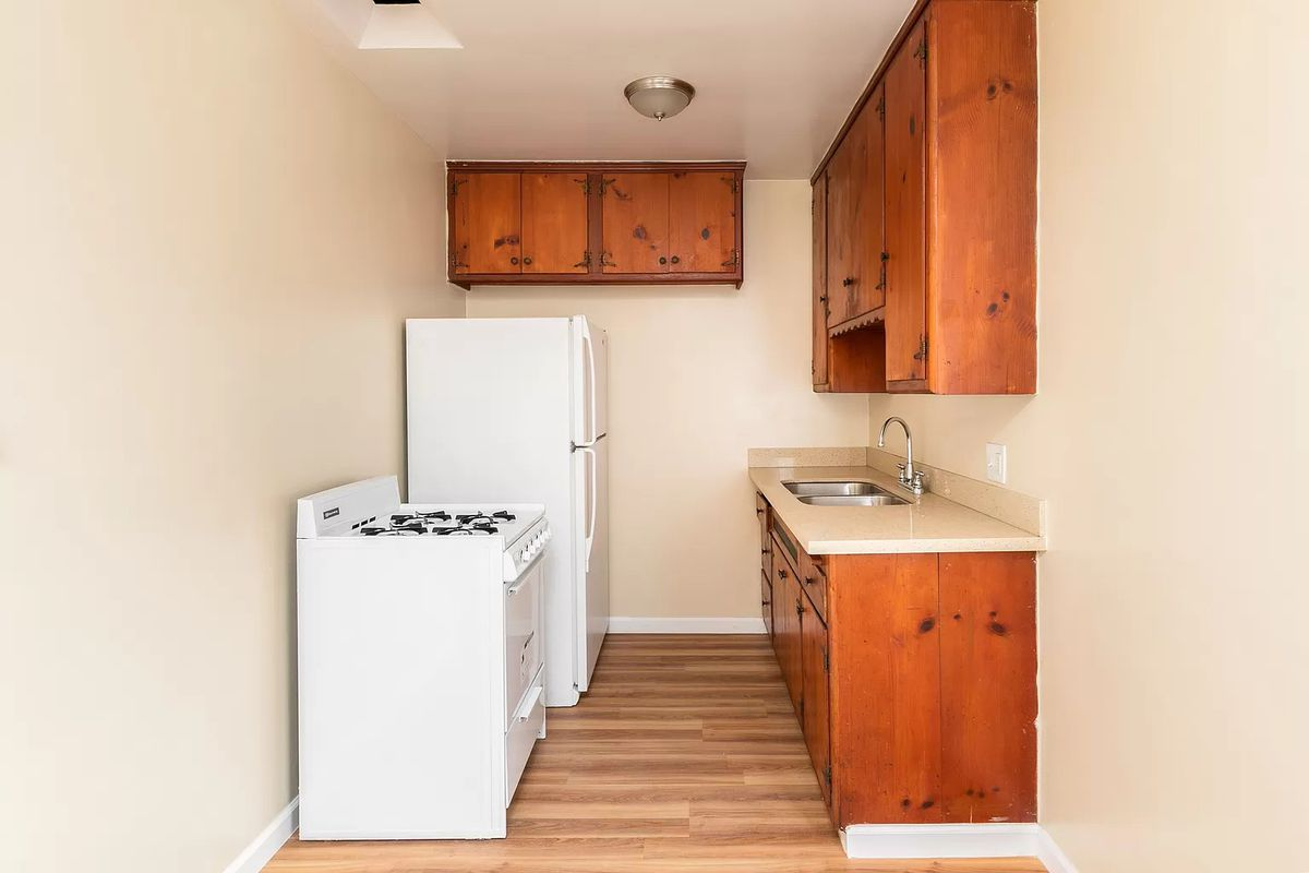 Small kitchen with older appliances