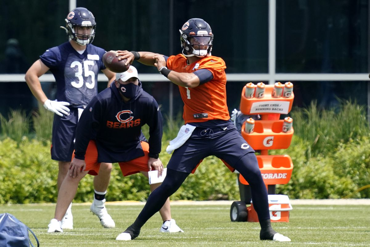 Bears quarterback Justin Fields throws a pass during OTA practices.