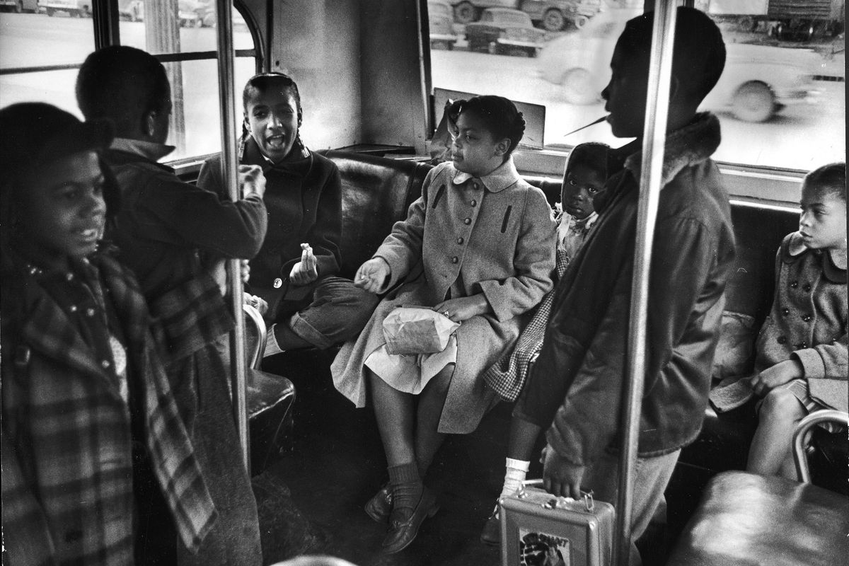 Linda Brown (center) and her sister Terry Lynn (far right) sit on a bus as they ride to the racially segregated Monroe Elementary School, Topeka, Kansas, March 1953. (Photo by Carl Iwasaki/The LIFE Images Collection/Getty Images)