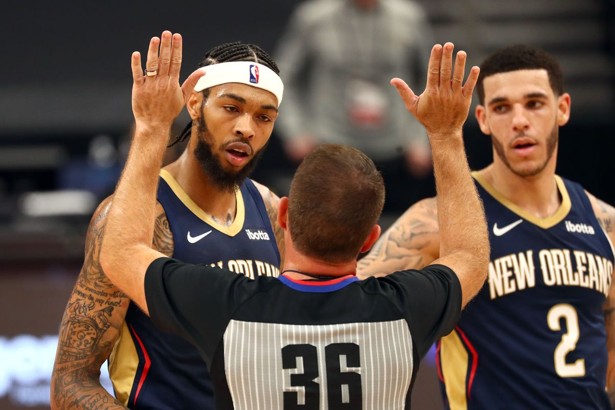 New Orleans Pelicans forward Brandon Ingram and New Orleans Pelicans guard Lonzo Ball tall with the referee during the second half at Amalie Arena.