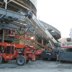6:17 p.m. Equipment parked outside the main bleacher gate -