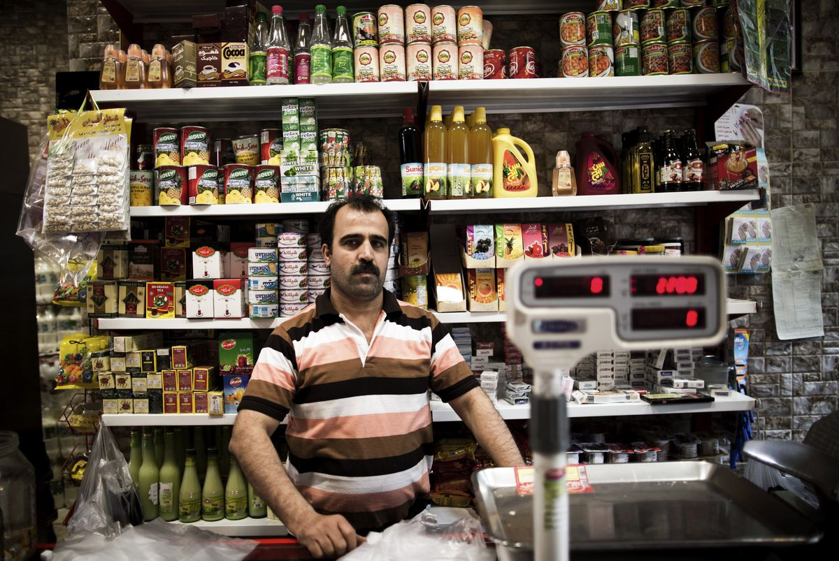 An Iranian grocery owner at his store in Tehran (BEHROUZ MEHRI/AFP/Getty)