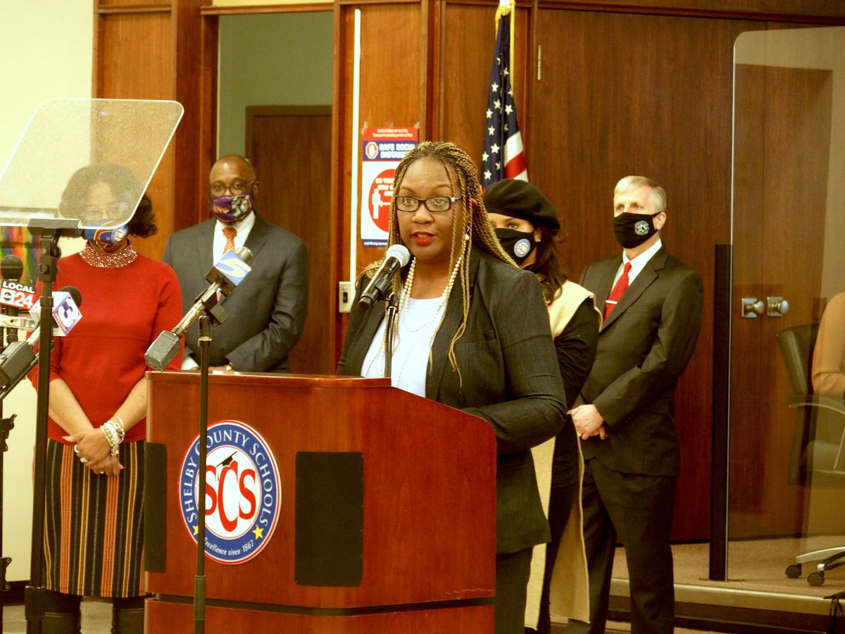 Danette Stokes stands at a podium in Shelby County Schools' central office auditorium.