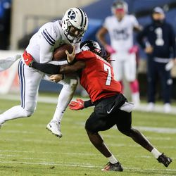 Brigham Young Cougars quarterback Zach Wilson (1) carries the ball for a first down against Western Kentucky Hilltoppers defensive back Trae Meadows (7) during an NCAA football game at LaVell Edwards Stadium in Provo on Saturday, Oct. 31, 2020.