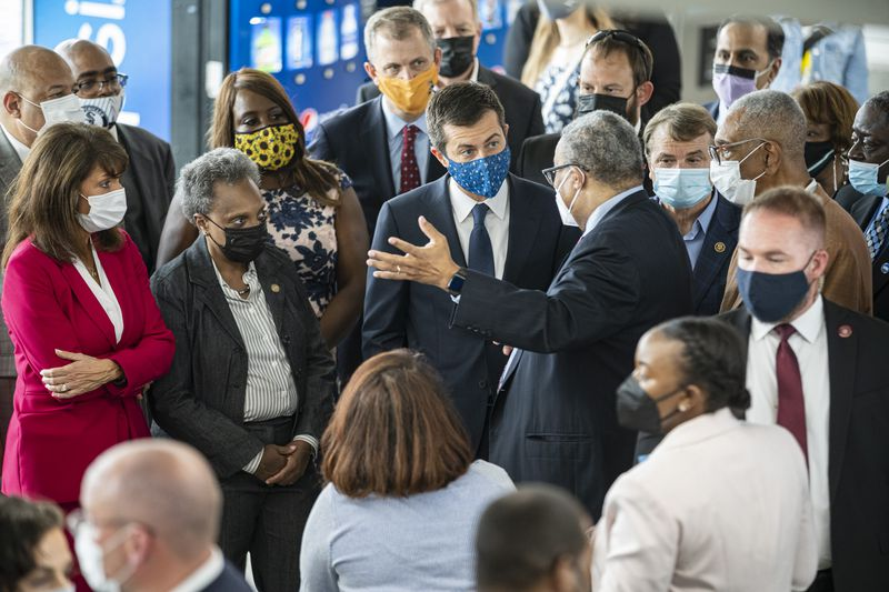 CTA President Dorval R. Carter, Jr. speaks with Transportation Secretary Pete Buttigieg, Mayor Lori Lightfoot and U.S. Rep. Marie Newman during a tour of the CTA Red Line 95th St/ Dan Ryan Station on Friday.