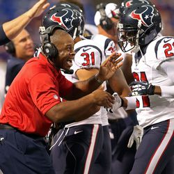Aug 9, 2013; Minneapolis, MN, USA; Houston Texans defensive backs coach Vance Joseph celebrates with Texans defensive back Shiloh Keo (31) after in interception in the first quarter against the Minnesota Vikings at the Metrodome.