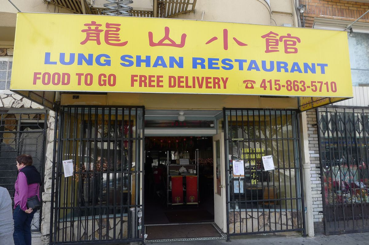 A typical old Chinese restaurant called Lung Shan with a yellow awning.
