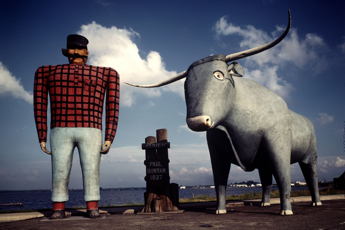 Painted concrete sculpture of Paul Bunyon and his