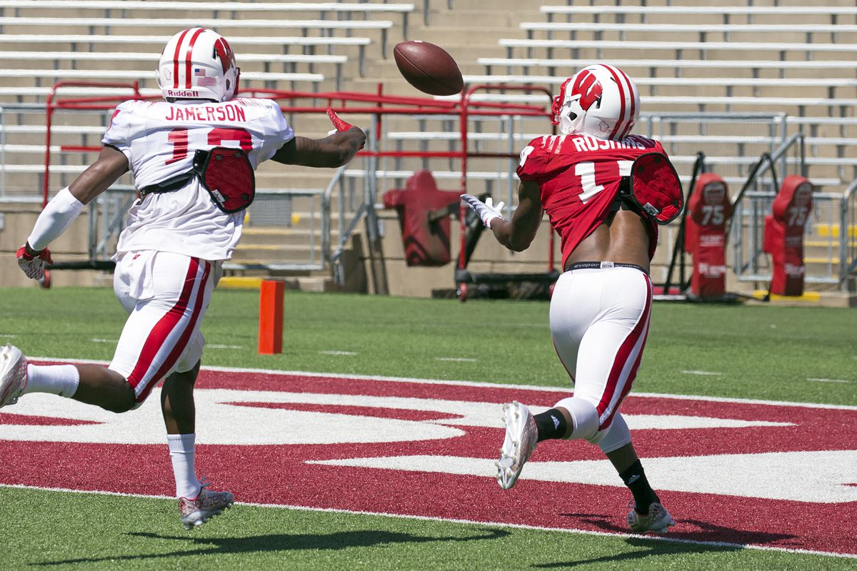 George Rushing hauls in a touchdown ahead of Natrell Jamerson in Wisconsin's spring game Saturday.