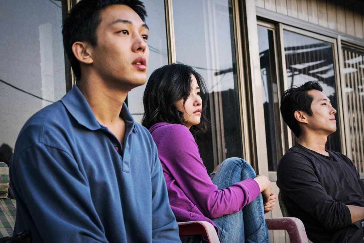 Still from the movie 'Burning' of a woman sitting between two men
