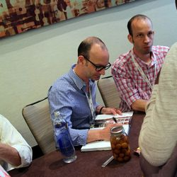 The Lee brothers signing books.