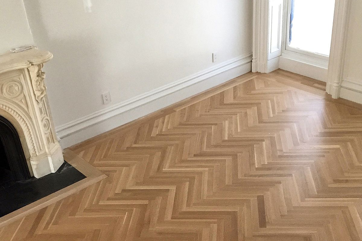The herringbone white oak flooring newly installed in the parlor level. Photo by Buck Projects.