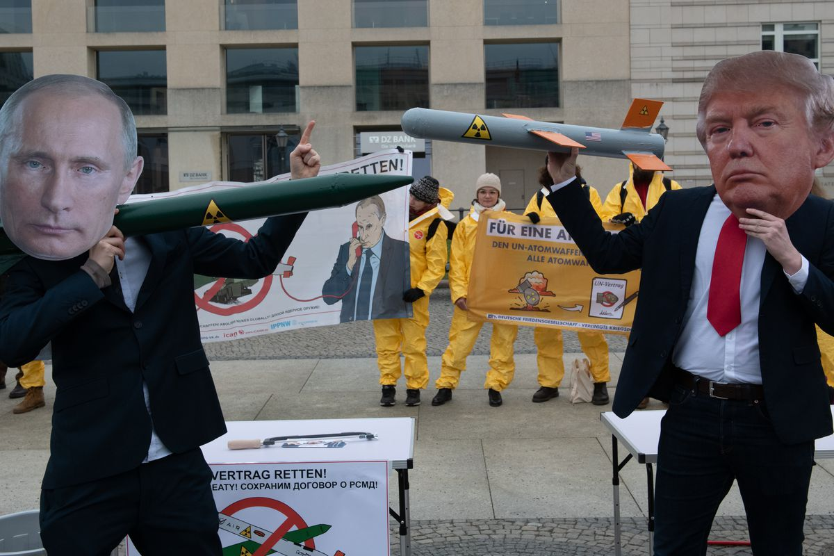 Demonstrators mocking Russian President Vladimir Putin and US President Donald Trump face each other with rocket models. They are protesting with their action against the imminent end of the INF disarmament agreement between Russia and the USA on February