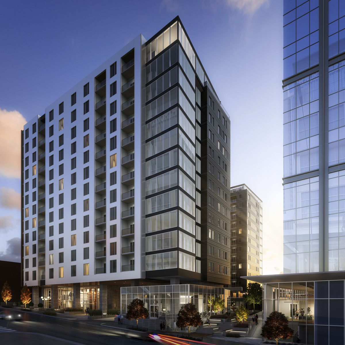 A condo tower with another glassy tower beside it, in renderings.
