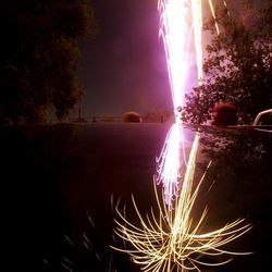 Fireworks are seen reflected in a car's sunroof as the city of Holladay celebrates the Fourth of July at Holladay Elementary School on Monday, July 4, 2005.