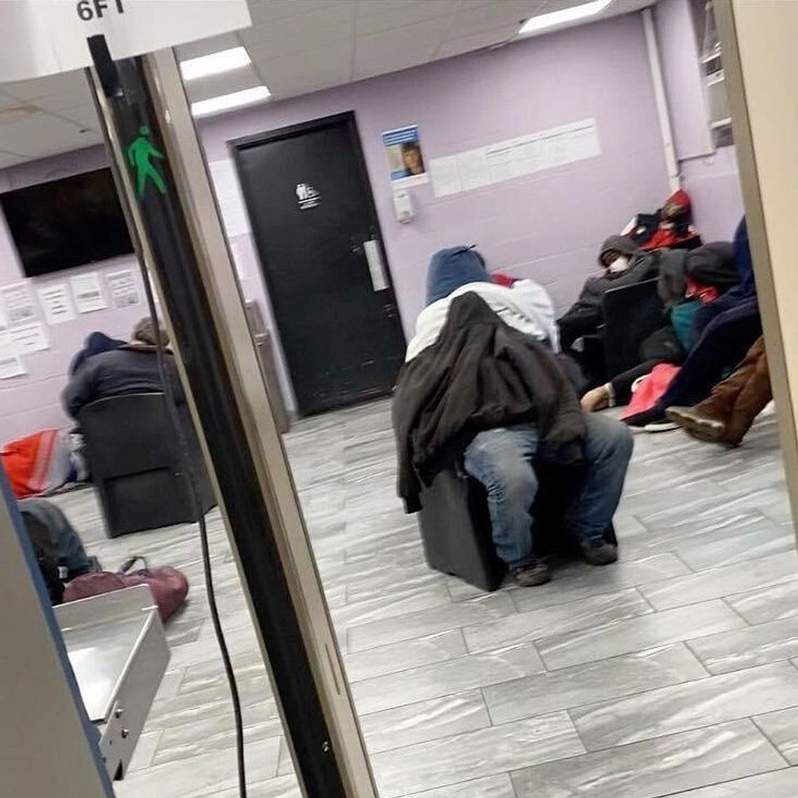 Homeless people were packed into a waiting area at the Schwartz Assessment Shelter on Wards Island during the coronavirus outbreak.