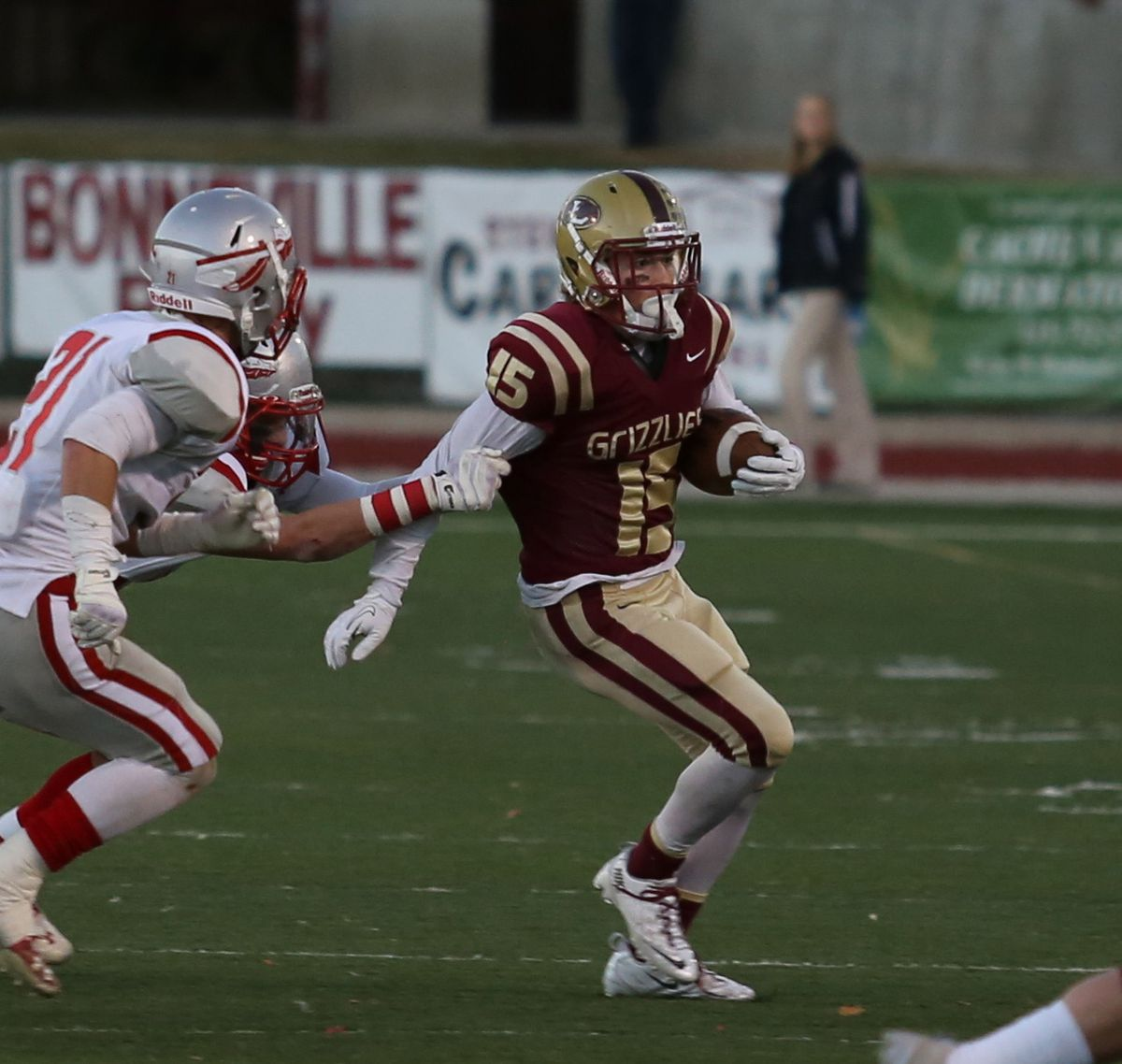 Logan's Taylor Compton, 15, runs the ball during the first-round 4A playoffs.