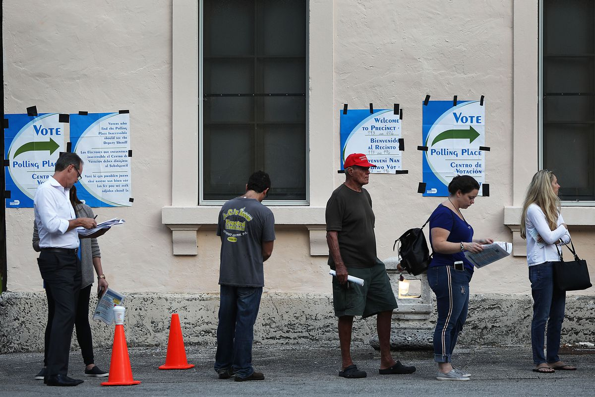 Voters line up to cast their ballot just before the polls open in the mid-term election on November 06, 2018 in Miami, Florida.