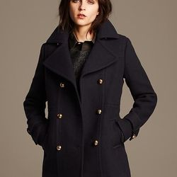 """The moment you plan shoulder-baring outfits for a warm weekend is the moment the temperatures drop. Keep this navy wool peacoat, $250 at <a href=""""http://bananarepublic.gap.com/browse/product.do?cid=87049&vid=1&pid=129357002"""">Banana Republic</a>, in your c"""