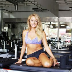 """<strong><a href=""""http://la.racked.com/archives/2014/08/14/hottest_trainer_contestant_8_jacquelyn_umof.php"""">Jacquelyn Umof, RockIt Body Pilates</a></strong>: Latin tunes are this former Laker Girl's beat of choice for getting the perfect booty. """"I'm loving"""