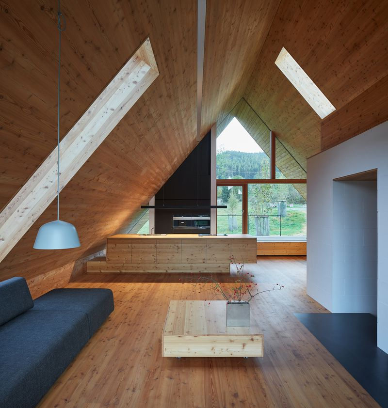 Living room with pointed ceiling